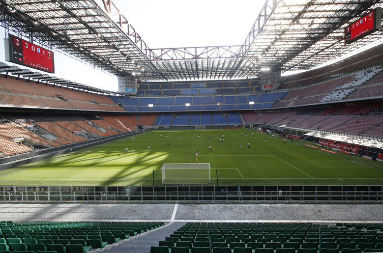 """FILE – In this Sunday, March 8, 2020 file photo, a view of the empty San Siro stadium during the Serie A soccer match between AC Milan and Genoa, in Milan, Italy. The Italian soccer players' association rejected a proposal from Serie A clubs Monday to reduce salaries by a third if the season does not resume as """"unmanageable."""" The guideline austerity measure was agreed on by 19 of the 20 clubs, the Italian league announced, with Juventus not included because it already finalized a deal with its players to relieve financial pressure on the eight-time defending champion amid the coronavirus pandemic. (AP Photo/Antonio Calanni, File)"""