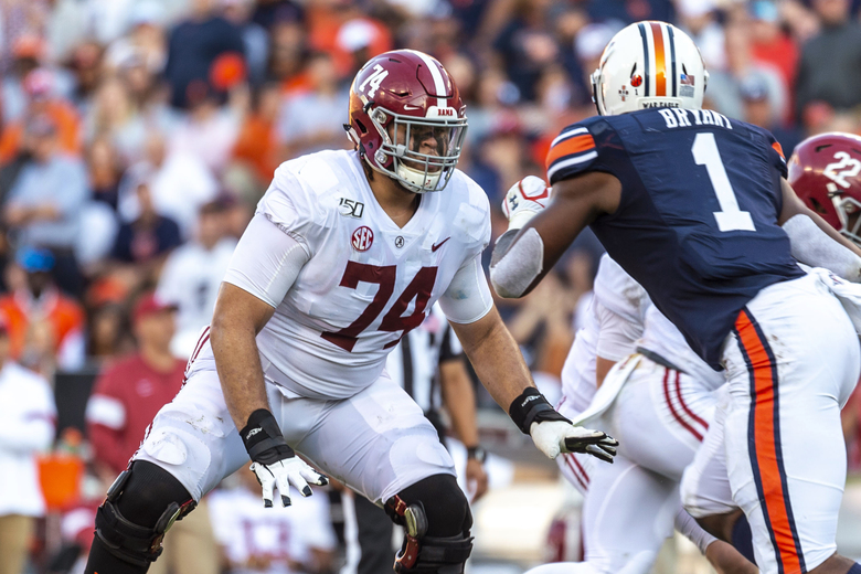 FILE – In this Nov. 30, 2019, file photo, Alabama offensive lineman Jedrick Wills Jr. (74) sets up to block against Auburn defensive lineman Big Kat Bryant (1) during the first half of an NCAA college football game in Auburn, Ala. Wills allowed one sack in 39 college games, playing exclusively at right tackle. (AP Photo/Vasha Hunt, File)