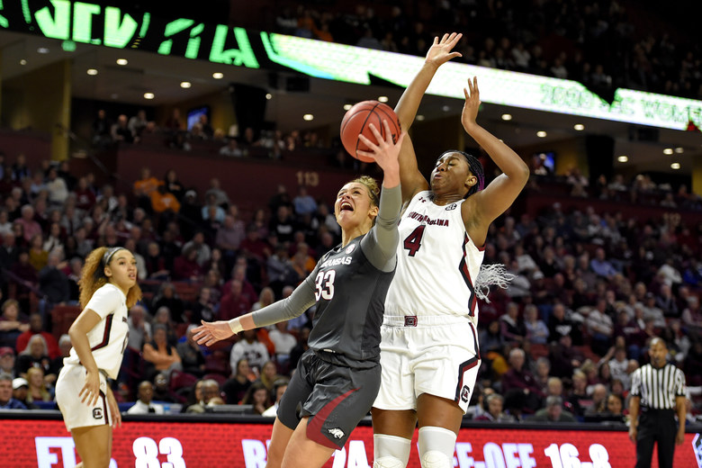 Arkansas' Chelsea Dungee (33) shoots while defended by South Carolina's Aliyah Boston (4) during a semifinal match at the Southeastern Conference women's NCAA college basketball tournament in Greenville, S.C., Saturday, March 7, 2020. (AP Photo/Richard Shiro)