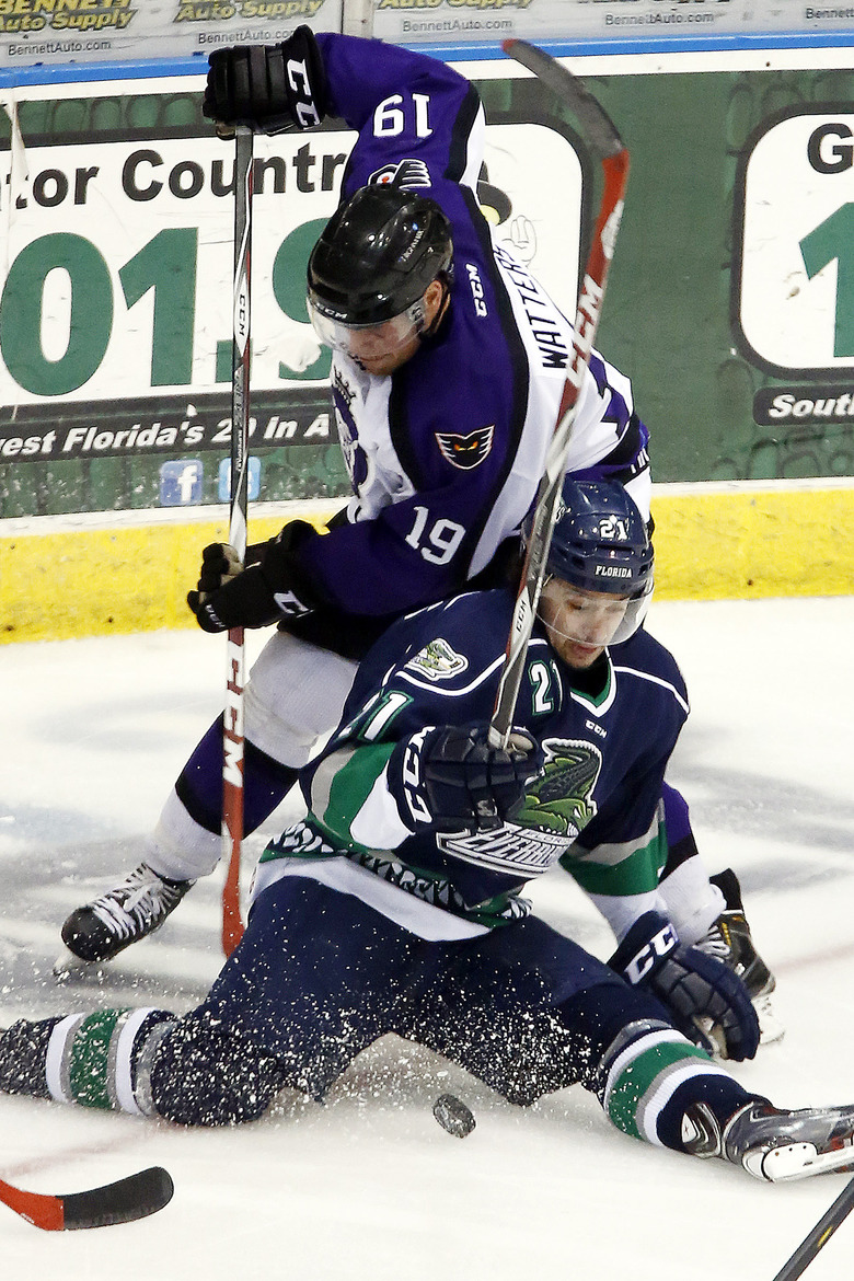 FILE – In this April 1, 2015, file photo, Florida Everblades' Spencer Pommells, bottom, is pressured by Reading Royals' Ian Watters (19) duirng the third period of an ECHL hockey game in Estero, Fla. The ECHL season was canceled because of the coronavirus pandemic. (AP Photo/Naples Daily News, Core Perrine)