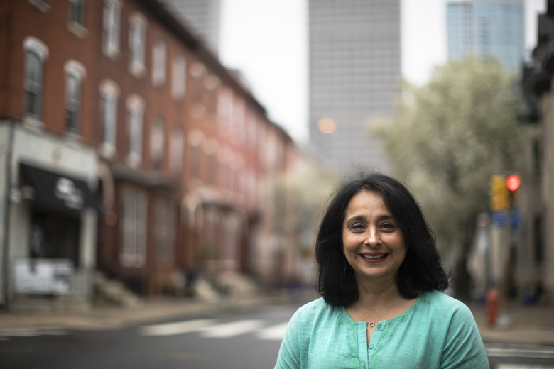 Suhag Shukla poses for a photograph in Philadelphia, Tuesday, March 31, 2020. Hindus around the world are in the midst of a 9-day celebration called Chaitra Navaratri that began with what for many is considered the Hindu New Year and will culminate with the festival of Ramanavami. Normally Shukla would be scrubbing her Philadelphia home more intensely than usual, a sign of the renewal the holiday signifies. There would be guests and Temple worship. But the temples are empty and the bells that worshippers ring are silent. (AP Photo/Matt Rourke)