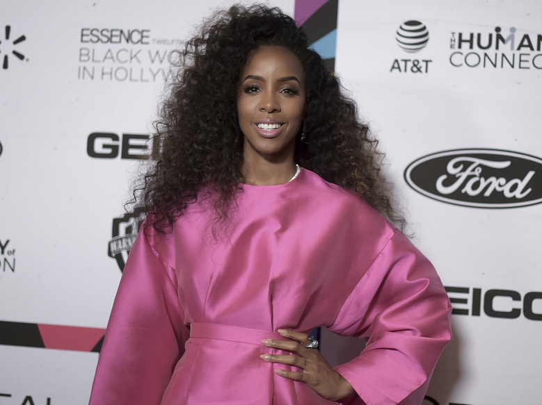 "FILE – This Feb. 21, 2019 file photo shows Kelly Rowland at the 12th Annual ESSENCE Black Women in Hollywood Awards in Beverly Hills, Calif. Rowland says her new single ""Coffee"" and its accompanying music video is her ""ode to the beauty of black women."" She debuted the breezy R&B track and video featuring black women across a spectrum of shades and colors two weeks ago. (Photo by Richard Shotwell/Invision/AP, File)"