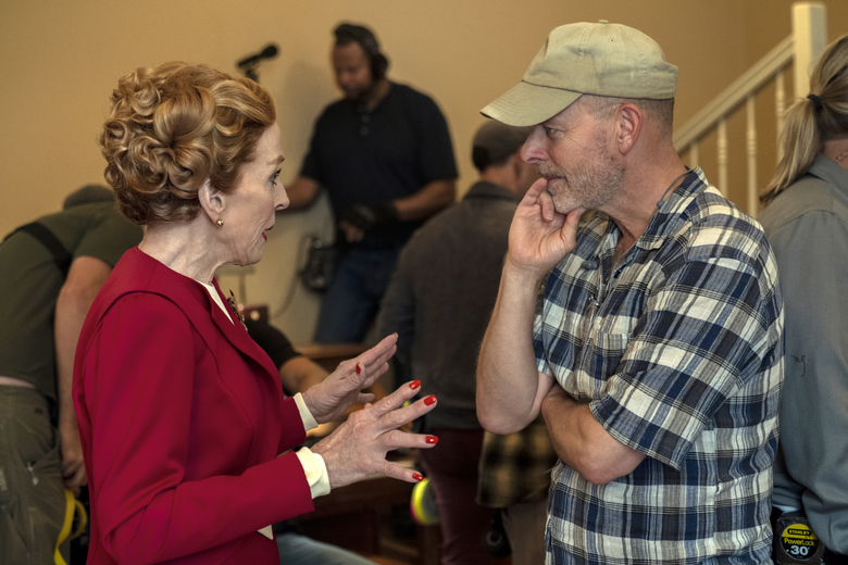 """This image released by Netflix shows actress Holland Taylor, left, speaking with Ryan Murphy on the set of """"Hollywood.""""  The series premieres May 1 on Netflix. (Saeed Adyani/Netflix via AP)"""