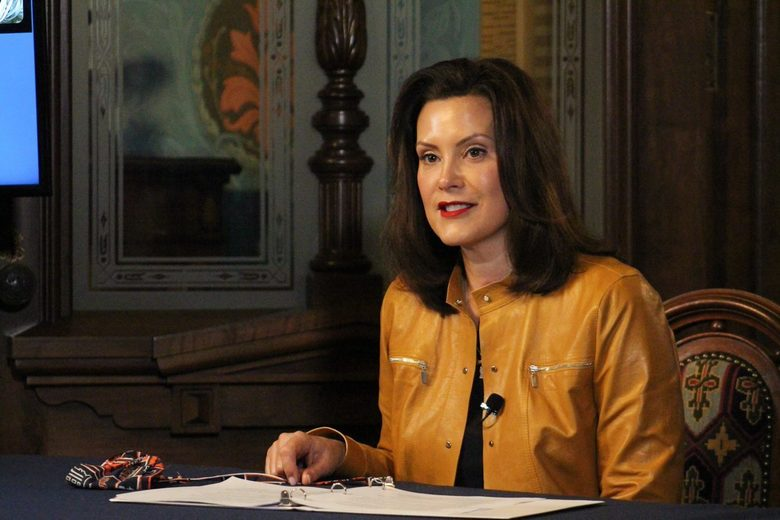 """In this image provided by the Michigan Office of the Governor, Michigan Gov. Gretchen Whitmer addresses the state during a speech in Lansing, Mich., Monday, April 6, 2020. Whitmer said Detroit-area hospitals are running """"dangerously low"""" on personal protection equipment during the COVID-19 pandemic. She also reported an """"incredible surge"""" in the number of unemployment claims and promised that people would get paid, despite computer woes and bureaucratic red tape. (Michigan Office of the Governor via AP)"""