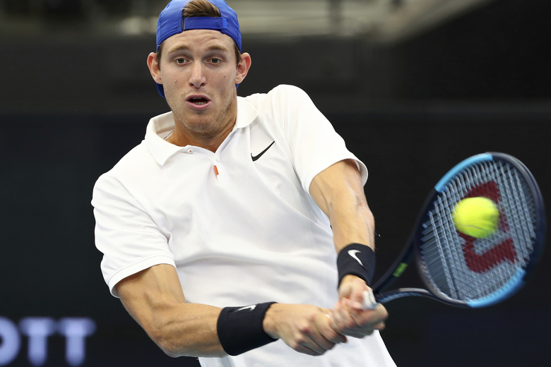 FILE – In this Jan. 4, 2020 file photo, Chile's Nicolas Jarry plays a shot during his match against France's Benoit Paire at the ATP Cup tennis tournament in Brisbane, Australia. The top 100 tennis player was given an 11-month doping ban by the International Tennis Federation on Monday, April 20, 2020, stemming from a failed test at the Davis Cup Finals in November. (AP Photo/Tertius Pickard, File)