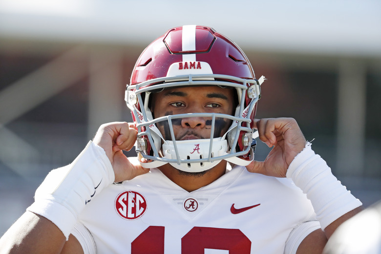 FILE – In this Nov. 16, 2019, file photo, Alabama quarterback Tua Tagovailoa (13) adjusts his helmet before an NCAA college football game against Mississippi State in Starkville, Miss. The Washington Redskins could shock everyone and take Alabama's Tua Tagovailoa either second overall or after trading down at the NFL Draft. (AP Photo/Rogelio V. Solis, Fle)
