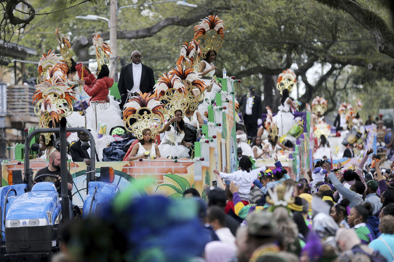 The Krewe of Zulu Parade on Mardi Gras Day Feb. 25 in New Orleans. In a city ravaged by the coronavirus outbreak, Zulu and its members have paid a heavy price. Several of the group's members have died from coronavirus-related complications, said Zulu President Elroy A. James. Multiple other members have tested positive. (AP Photo/Rusty Costanza, file)