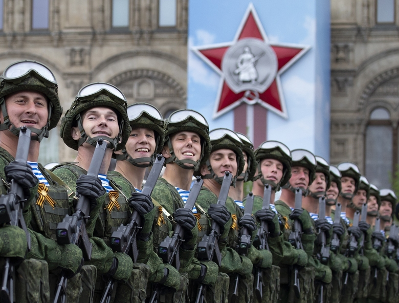FILE In this file photo taken on Thursday, May 9, 2019, Russian troops march during the Victory Day military parade to celebrate 74 years since the victory in WWII in Red Square in Moscow, Russia. Russian President Vladimir Putin has ordered the postponement of a Victory Day parade marking the 75th anniversary of the end of World War II, citing the ongoing public health threat from the coronavirus pandemic. Speaking in televised remarks on Thursday, April 16, 2020, Putin said the festivities would be held later this year. (AP Photo/Alexander Zemlianichenko, File)