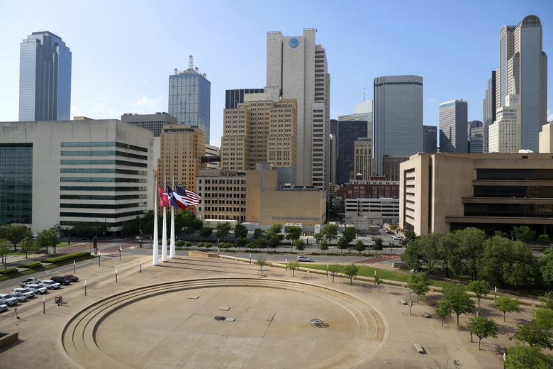 A view of downtown Dallas, before a news conference at City Hall, Wednesday, April 22, 2020. An otherwise heavily trafficked area, the city sits mostly quiet amid the new coronavirus crisis. (AP Photo/Tony Gutierrez)