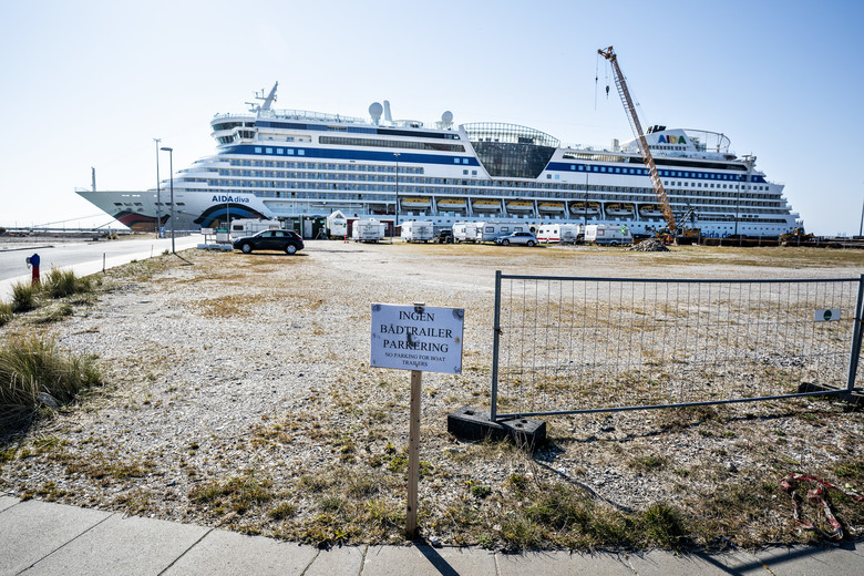 The quarantined Italian cruise ship Aidadiva that is hit by coronavirus and is docked in Skagen harbour at the most northern point in Denmark, Monday April 6, 2020.  Authorities have said that the ship is set to stay for a month at the port, and the hundreds of crew members are kept isolated and cannot disembark from the ship. (Henning Bagger/Ritzau Scanpix via AP)