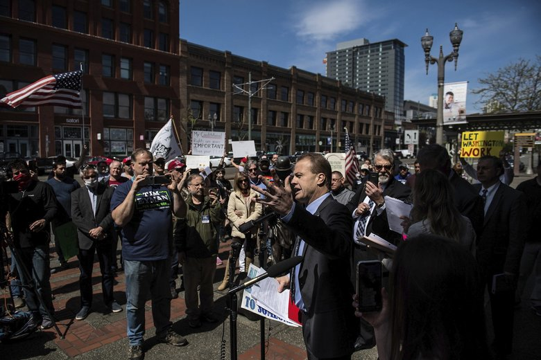 Tim Eyman speaks outside the U.S. District Courthouse in Tacoma on Friday about the lawsuit against Gov. Jay Inslee. (Joshua Bessex / The News Tribune via AP)