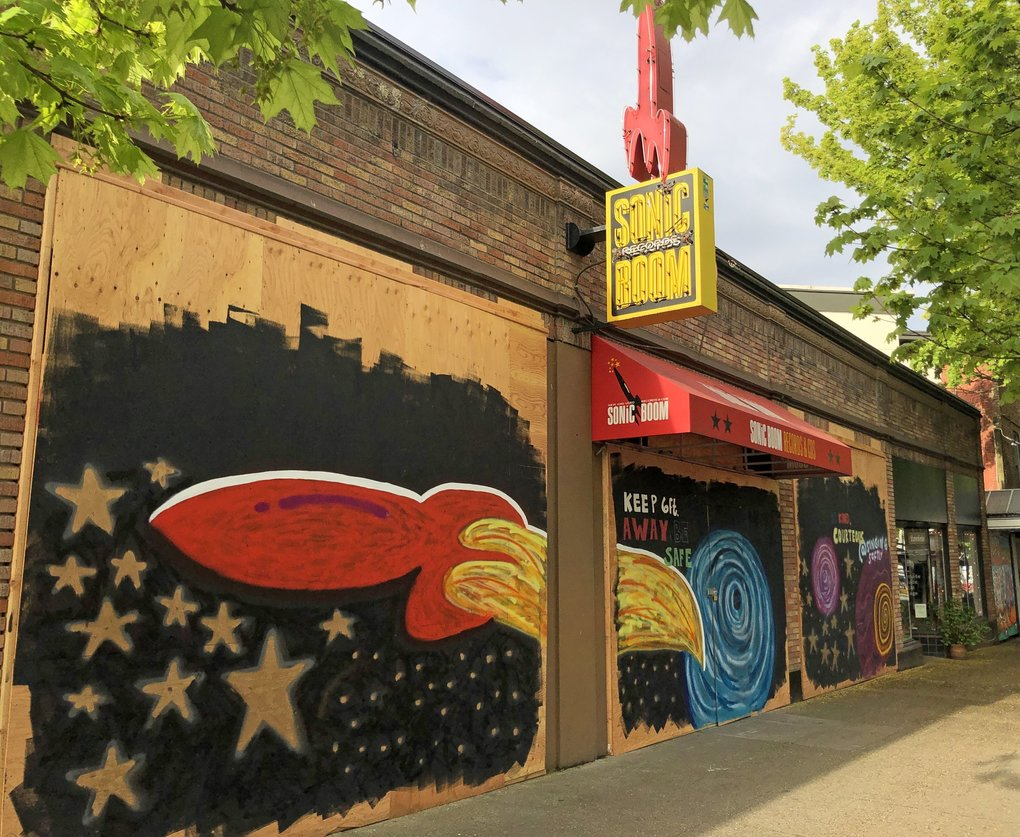 """Sonic Boom Records in Ballard will offer curbside pickup orders in accordance with Gov. Jay Inslee's four-phase plan to reopen Washington's economy. """"I'll be excited to have the boards off the place and the lights on,"""" owner Mike Pitts says. (Courtesy of Mike Pitts)"""