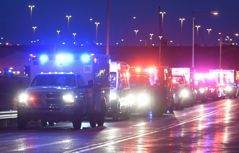 The procession of emergency vehicles for retired paramedic Paul Cary makes its way out of Denver International Airport on Sunday, May 3, 2020m, in Denver. Cary died from coronavirus after volunteering to help combat the pandemic in New York City. (Helen H. Richardson/The Denver Post via AP, Pool) CODEN329 CODEN329