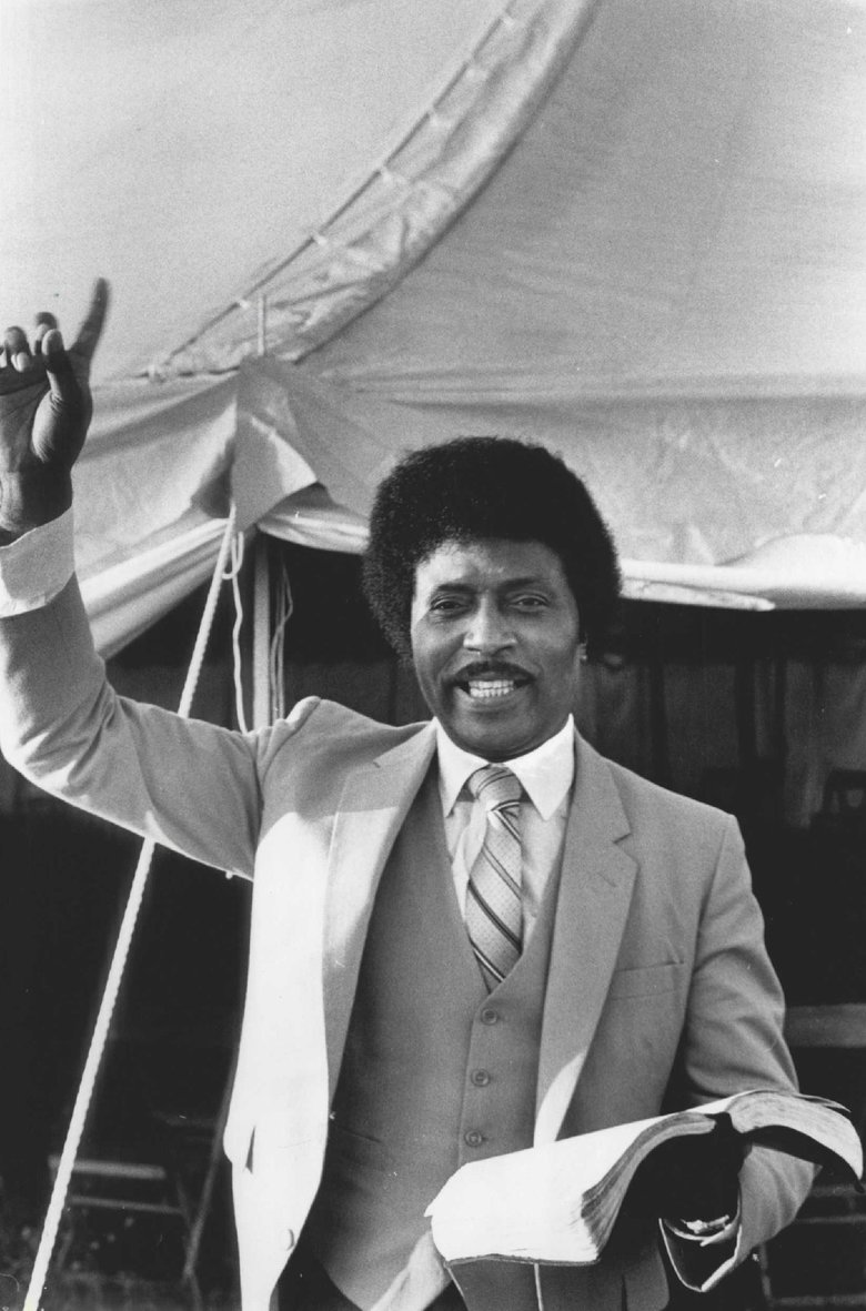Little Richard and his Bible outside the gospel tent in Puyallup in 1981. (Peter Liddell / The Seattle Times, file)