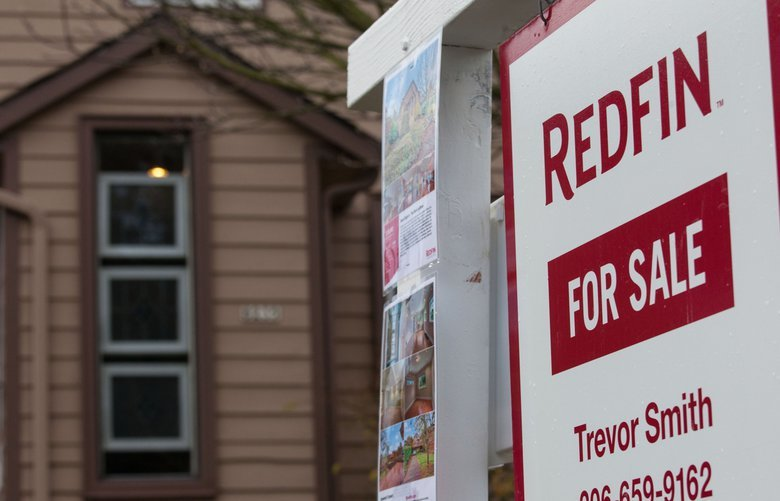 "A Redfin Corp. ""For Sale"" sign stands outside of a home in Seattle, Washington, U.S., on Tuesday, Nov. 19, 2013. Purchases of previously-owned U.S. homes fell in October to the lowest level in four months as limited supply and higher mortgage rates restrained momentum in the housing-market recovery. Photographer: David Ryder/Bloomberg"