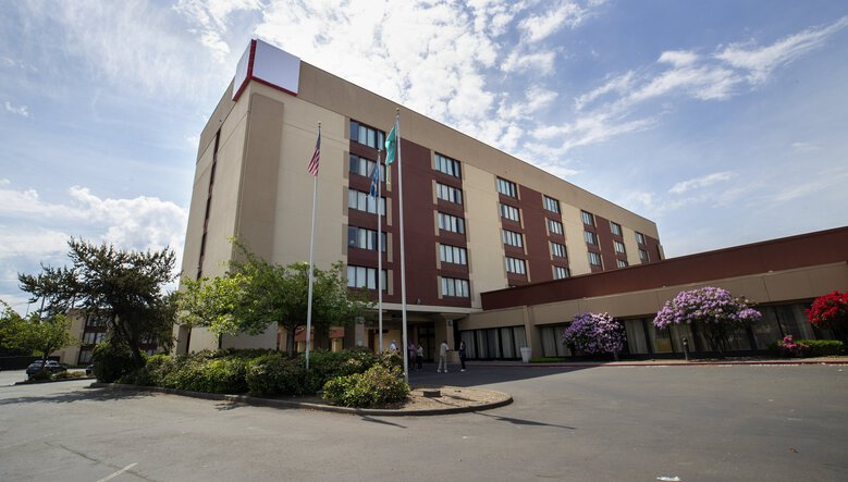 The Red Lion hotel in Renton. King County paid to put the equivalent of an entire downtown shelter into the hotel to protect the residents from COVID-19. Calls to police in the first month have been far fewer than during the same month last year at the downtown Seattle DESC shelter. (Ellen M. Banner / The Seattle Times)