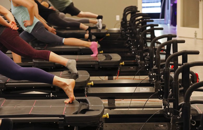 A group works out on Megaformer M3 machines during a Lagree Pilates class at Inspire, on Queen Anne, Monday, Oct. 9, 2017, in Seattle. 203618