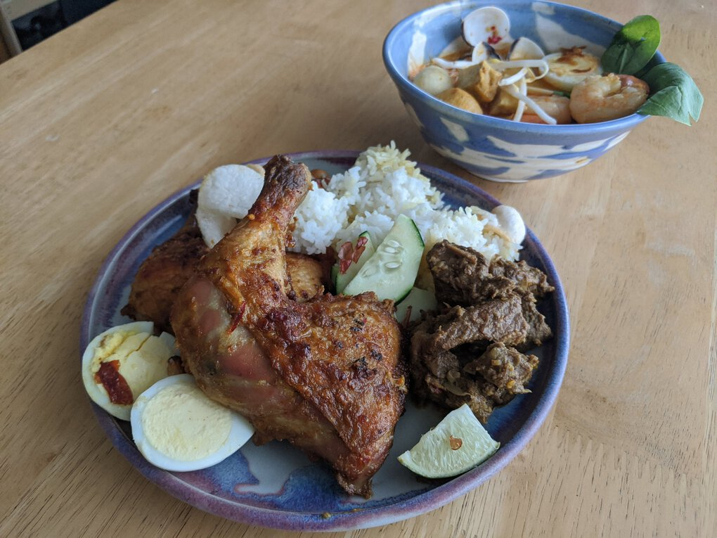Kirkland's Reunion specializes in Malaysian fare, such as nyonya laksa seafoodand chili-rubbed roast chicken and lemongrass beef. (Jackie Varriano / The Seattle Times)