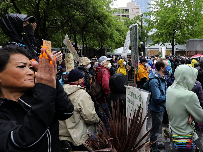 Speakers are applauded in Westlake Park during a peaceful protest at Westlake Park while a more violent group of protesters raged nearby.    Protests on Saturday May 30, 2020  (Alan Berner / The Seattle Times)