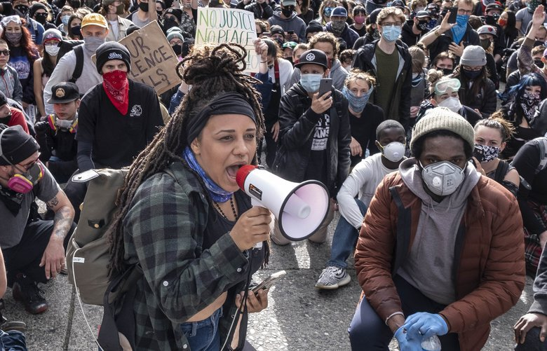 The day following Saturday's rioting in downtown Seattle began with an army of volunteers determined to wash away the stains of the night before, and continued with new demonstrations against Police violence.  Photographed Sunday May 31, 2020 214107
