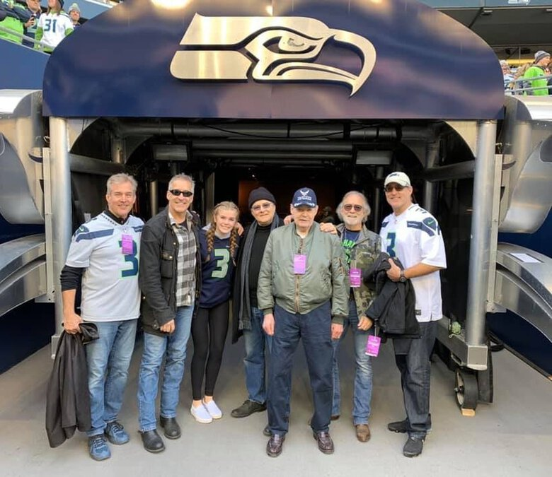 Lucky Bourgoin, surrounded by his family, was honored at a Seahawks game last fall. (Courtesy the Bourgoin family)