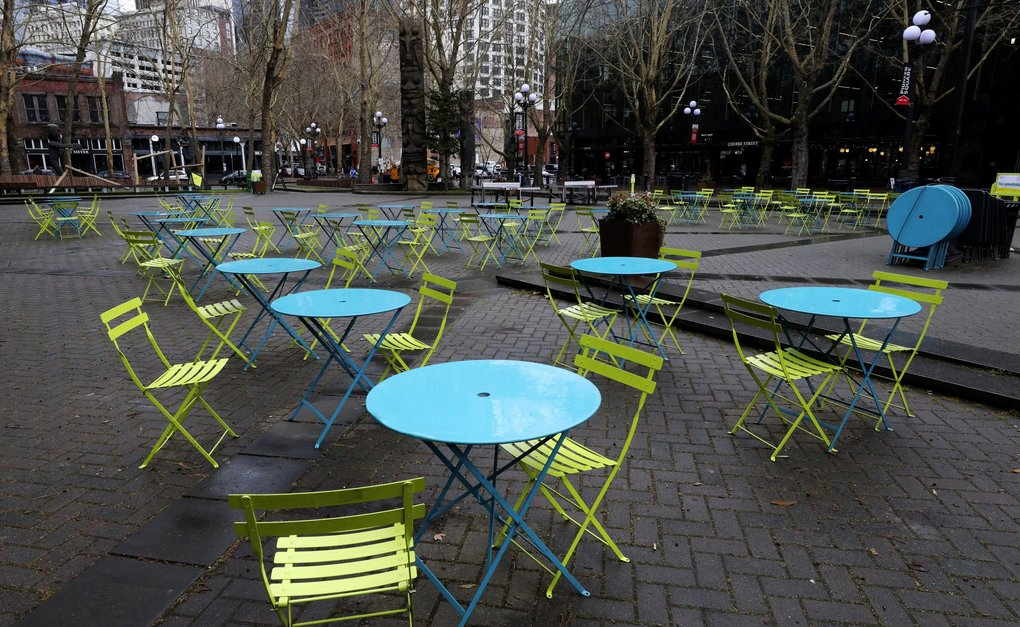 Occidental Park, also called Occidental Square, is virtually vacant even at mid-day in March, as the coronavirus outbreak broadens. (Alan Berner / The Seattle Times)