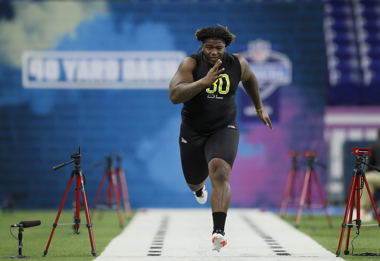 LSU offensive lineman Damien Lewis runs the 40-yard dash at the NFL football scouting combine in Indianapolis, Friday, Feb. 28, 2020. (Charlie Neibergall / AP)