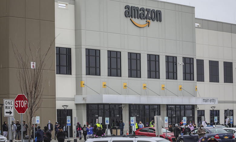 Workers at Amazon's fulfillment center in Staten Island, N.Y., gather outside to protest work conditions in the company's warehouse, Monday March 30, 2020. Workers say Amazon is not doing enough to keep workers safe from the spread of coronavirus. (AP Photo / Bebeto Matthews, File)