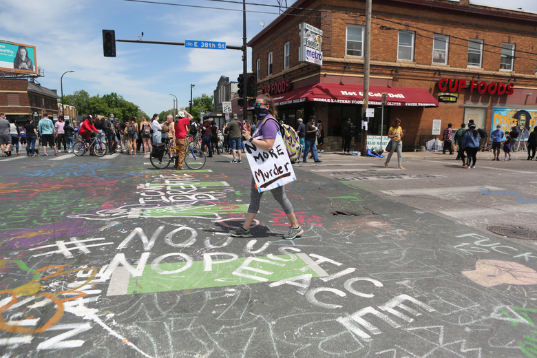People inspect the area around Cup Foods in Minneapolis, Thursday, May 28, 2020, near where George Floyd was taken into custody. A wave of protests erupted across South Minneapolis overnight and into Thursday, with the police firing tear gas and rubber bullets as people set buildings on fire and looted stores days after George Floyd, an African-American man, died in police custody. (Jenn Ackerman/The New York Times)