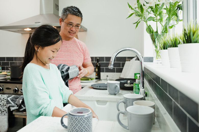Don't go it alone. Enlist the whole family in keeping up with the increased number of chores. (Getty Images)