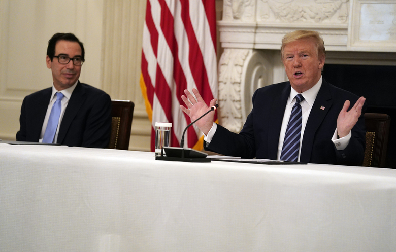 President Donald Trump speaks during a meeting with Republican lawmakers, in the State Dining Room of the White House, Friday, May 8, 2020, in Washington. Treasury Secretary Steven Mnuchinlistens at left. (AP Photo/Evan Vucci)
