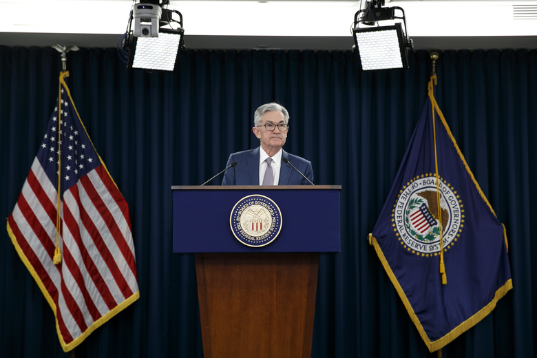 FILE – In this March 3, 2020 file photo, Federal Reserve Chair Jerome Powell speaks during a news conference to discuss an announcement from the Federal Open Market Committee, in Washington.  The Federal Reserve said Friday, April 24,  it had $85.8 billion in loans outstanding last week in three of the programs it rolled out last month to protect the economy during the coronavirus pandemic.  (AP Photo/Jacquelyn Martin, File)