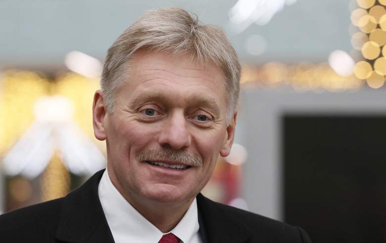 Kremlin spokesman Dmitry Peskov visits the Dream Island amusement park ahead of its upcoming inauguration in Moscow, Russia, Thursday, Feb. 27, 2020. (Shamil Zhumatov/Pool Photo via AP)