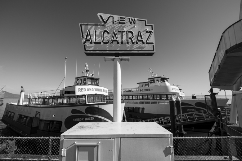 Bay cruise tour boats sit tied up to a pier at Fisherman's Wharf in San Francisco on April 24, 2020. Normally, the months leading into summer bring bustling crowds to the city's famous landmarks, but this year, because of the coronavirus threat they sit empty and quiet. Some parts are like eerie ghost towns or stark scenes from a science fiction movie. (AP Photo/Eric Risberg)