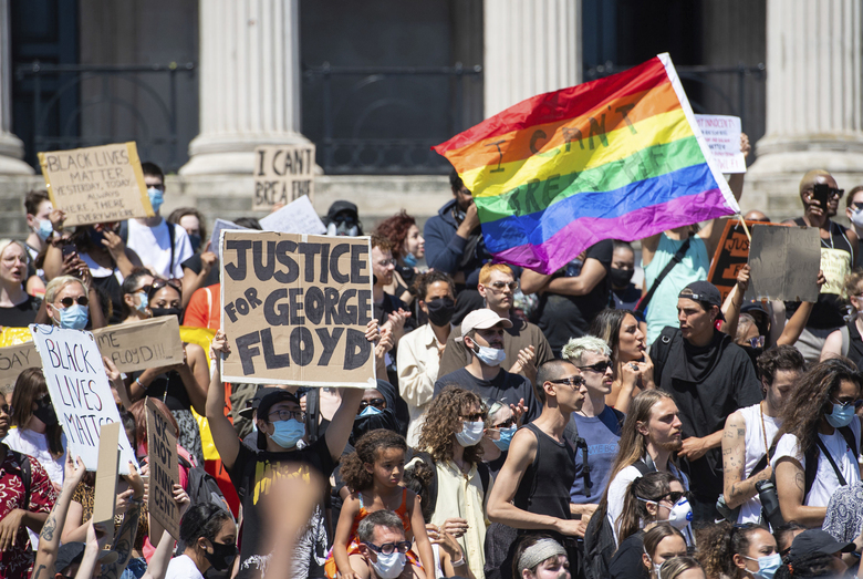 People gather in Trafalgar Square in central London on Sunday, May 31, 2020 to protest against the recent killing of George Floyd by police officers in Minneapolis that has led to protests across the US. (AP Photo/Dominic Lipinski)