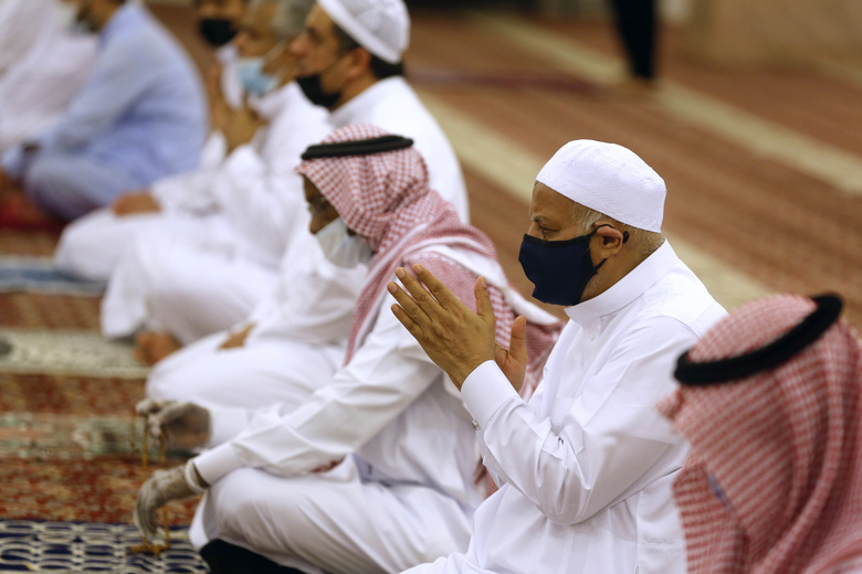 Worshippers wearing face masks to prevent the spread of COVID-19 prays at al-Mirabi Mosque in Jiddah, Saudi Arabia, Sunday, May 31, 2020. The Ministry of Islamic Affairs said mosques will open to the public for prayers from May 31 until June 20, except in Mecca, with precautionary measures and instructions. (AP Photo/Amr Nabil)