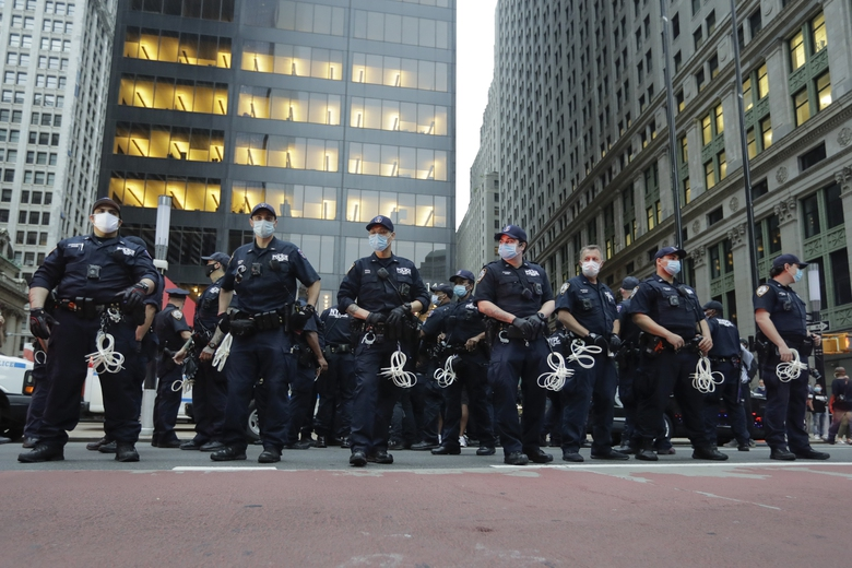 Police Officers watch over protesters during a rally over the death of George Floyd, a black man who was in police custody in Minneapolis Thursday, May 28, 2020, in New York. Floyd died after being restrained by Minneapolis police officers on Memorial Day. (AP Photo/Frank Franklin II)