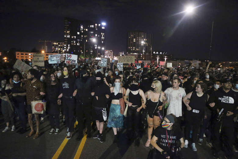 In this May 29, 2020, photo, Portlanders march from the George Floyd vigil at the Peninsula Park towards the Justice Center downtown Portland. Protests have been erupting all over the country after George Floyd died earlier this week in police custody in Minneapolis.  (Dave Killen/The Oregonian via AP)