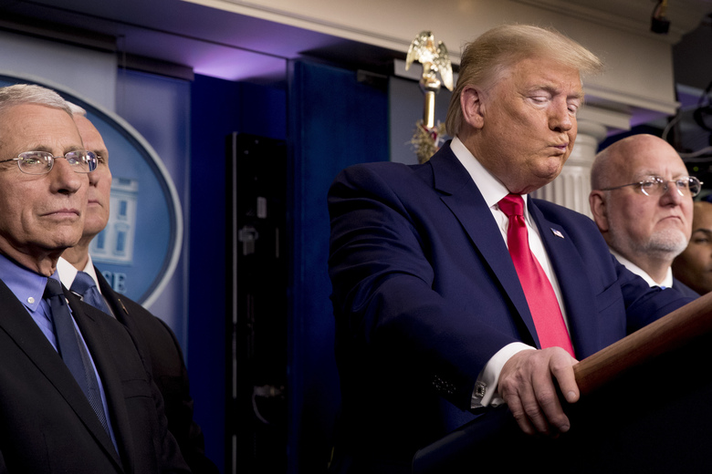 """In this Saturday, Feb. 29, 2020 file photo, President Donald Trump, accompanied by, from left, National Institute for Allergy and Infectious Diseases Director Dr. Anthony Fauci, Vice President Mike Pence, and Robert Redfield, director of the Centers for Disease Control and Prevention, reacts to a question during a news conference on the coronavirus in the press briefing room at the White House in Washington. Redfield said his faith had helped orient him toward the potential for """"greater good"""" to arise from tragedy. Faith and science have never been in tension for him, Redfield said. (AP Photo/Andrew Harnik)"""