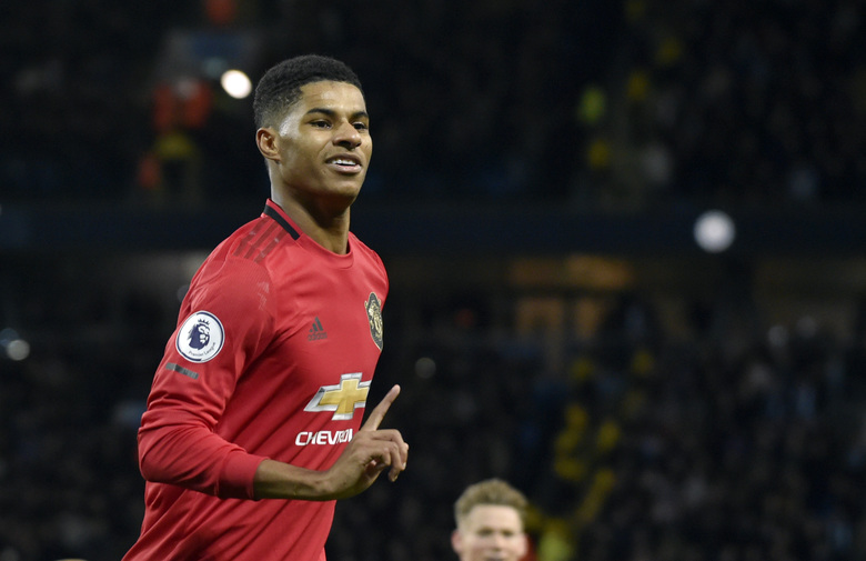 FILE – In this Saturday, Dec. 7, 2019 file photo, Manchester United's Marcus Rashford during their English Premier League soccer match against Manchester City at Etihad stadium in Manchester, England. Paul Pogba and Marcus Rashford are expected to be available for Manchester United whenever the Premier League is allowed to resume after its suspension because of the coronavirus outbreak. Rashford is United's top scorer and Pogba is the club's most high-profile player. They were both sidelined with long-term injuries at the time play was halted in England.  (AP Photo/Rui Vieira, file)