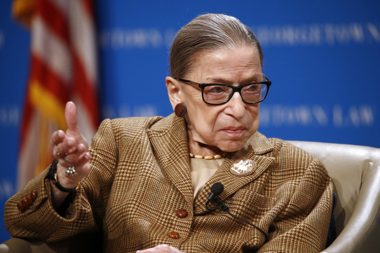 Supreme Court Associate Justice Ruth Bader Ginsburg speaks in February at Georgetown University Law Center in Washington. The Supreme Court says Ginsburg has been hospitalized with an infection caused by a gallstone. (AP Photo / Patrick Semansky, file)
