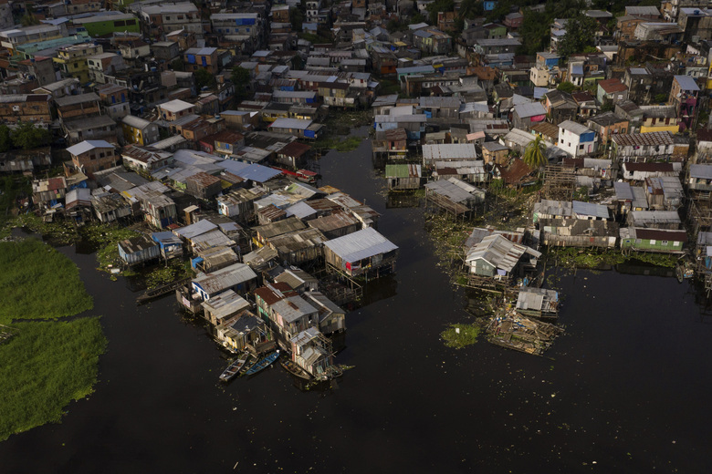 The riverside Educandos neighborhood is seen from above in Manaus, Brazil, Saturday, May 16, 2020. Per capita, Manaus is Brazil's major city hardest hit by COVID-19. (AP Photo/Felipe Dana)