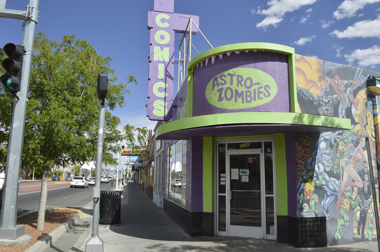 In this photo taken Monday, April 27, 2020, the Astro-Zombies comic shop in Albuquerque, N.M., sits closed due to a statewide health order to stop the spread of COVID-19. (AP Photo/Russell Contreras)