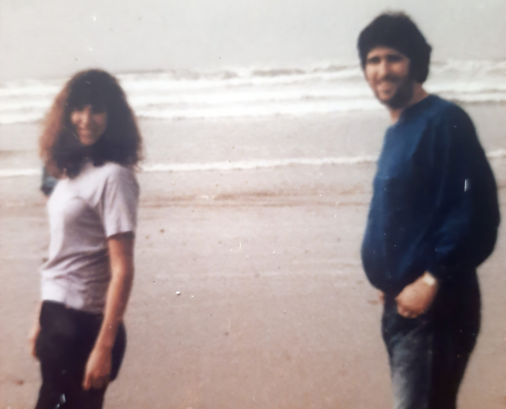 This photo provided by Tara Reade shows her and her half-brother Michael Enterline on the beach in Morro Bay, Calif., in 1989. (Tara Reade via AP)