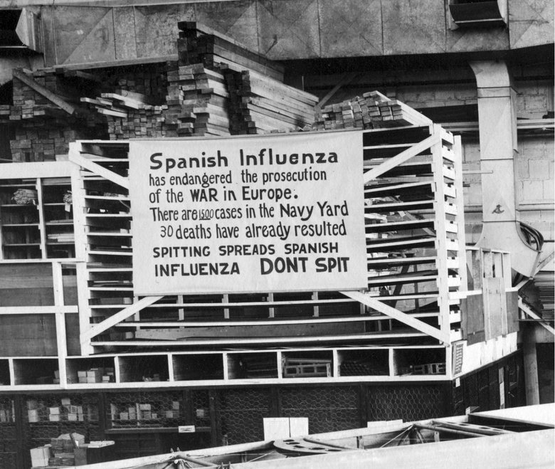 FILE – In this Oct. 19, 1918 file photo provide by the U.S. Naval History and Heritage Command a sign is posted at the Naval Aircraft Factory in Philadelphia that indicates, the Spanish Influenza was then extremely active. Science has ticked off some major accomplishments over the last century. The world learned about viruses, cured various diseases, made effective vaccines, developed instant communications and created elaborate public-health networks. Yet in many ways, 2020 is looking like 1918, the year the great influenza pandemic raged. (U.S. Naval History and Heritage Command via AP)
