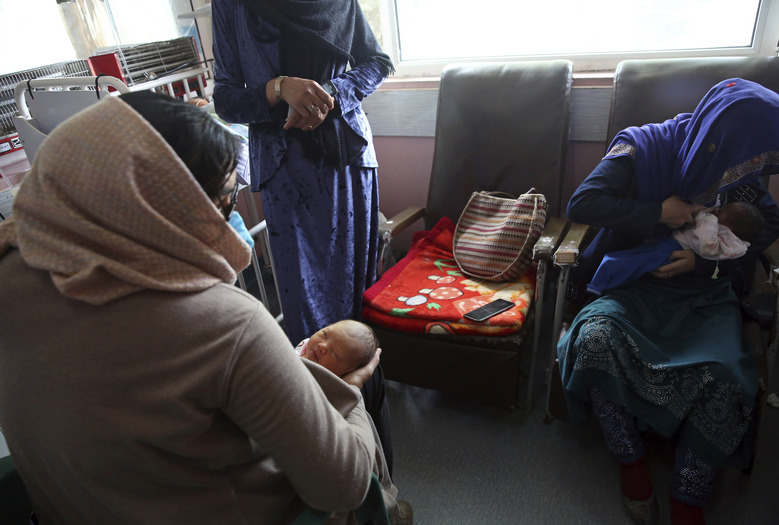 A mother, right, breastfeeds her two-day-old baby at the Ataturk Children's Hospital, a day after they were rescued from a deadly attack on another maternity hospital, in Kabul, Afghanistan, Wednesday, May 13, 2020. Militants stormed the Barchi National Maternity Hospital in the western part of Kabul on Tuesday, setting off an hours-long shootout with the police and killing tens of people, including two newborn babies, their mothers and an unspecified number of nurses, Afghan officials said. (AP Photo/Rahmat Gul)