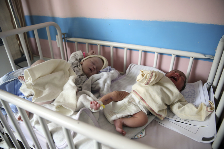 Newborn babies lie in their beds at the Ataturk Children's Hospital a day after they were rescued from a deadly attack on another maternity hospital, in Kabul, Afghanistan, Wednesday, May 13, 2020. Militants stormed the Barchi National Maternity Hospital in the western part of Kabul on Tuesday, setting off an hours-long shootout with the police and killing tens of people, including two newborn babies, their mothers and an unspecified number of nurses, Afghan officials said. (AP Photo/Rahmat Gul)
