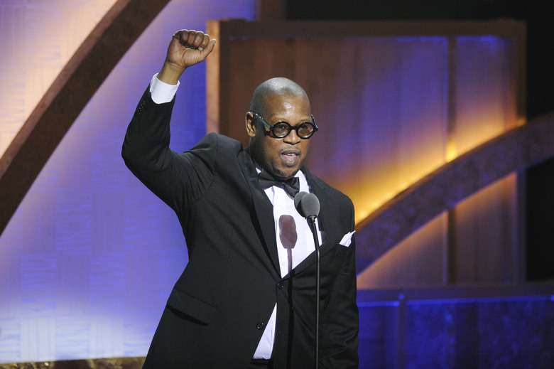 """FILE – In this Jan. 16, 2010 file photo, media executive Andre Harrell speaks during the 2010 BET Hip Hop Honors in Washington. A tribute to Harrell, the late music executive who discovered Sean """"Diddy"""" Combs and died earlier this month, will air Sunday on BET, BET Jams, BET Soul and REVOLT TV, where Harrell served as vice chairman.  (AP Photo/Nick Wass, File)"""