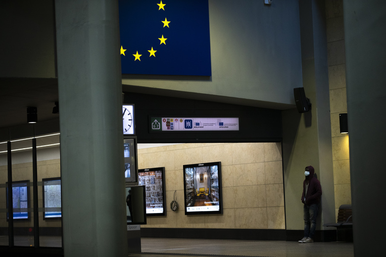 A man wearing a face mask to protect against coronavirus waits for a train at Schuman metro station during a gradual lifting of a lockdown to prevent the spread of the coronavirus, COVID-19, in Brussels, Tuesday, May 5, 2020. Belgium began relaxing some of its lockdown measures on Monday. Business-to-business companies can open their offices to employees again and those taking public transport must wear a mask. (AP Photo/Francisco Seco)