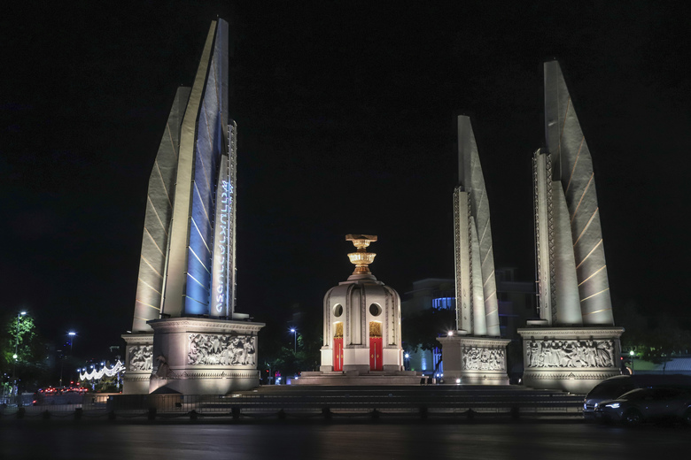 "In this Sunday, May 10, 2020. photo released by the Progressive Movement Group, shows images of ""hashtag #Finding Truth"" relating to the 2010 civil protests projected on the pillars of the Democracy Monument in Bangkok, Thailand, ahead of the upcoming 10th anniversary of the protests and following crackdowns. (Progressive Movement Group via AP)"